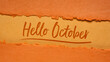 Leinwanddruck Bild - Hello October welcome note  - handwriting on a handmade rag paper in pumpkin orange tones, calendar concept