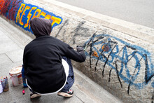 Woman Is Painting A Wall With ...