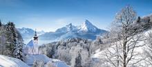 Maria Gern Church On Snowcapped Mountains Against Blue Sky