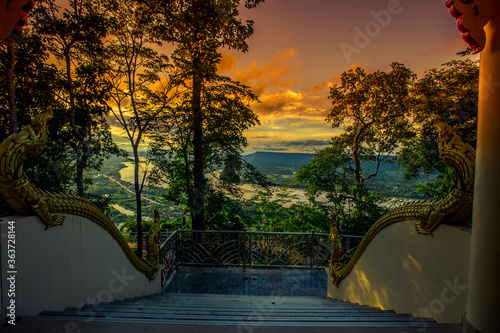 A high angle abstract background from the mountains, which can see the surrounding scenery (rivers, roads, communities, trees) and the evening twilight from the beautiful sky. - 363728144
