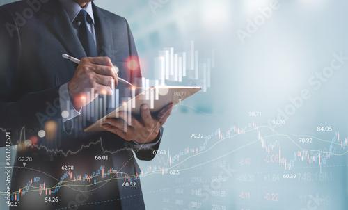 Fotografiet Finance analyst businessman analyzing stock market trend with forex graph on vir