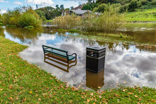 Empty Metal Bench In Flooded P...