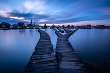 Pier Over River Against Sky At...