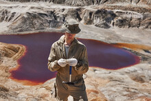 Geologist Examines A Sample Of...