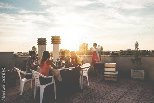 Fotografie, Obraz People Sitting On Table Against Sky