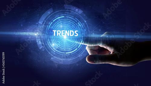 Fototapeta Hand touching TRENDS button, modern business technology concept obraz