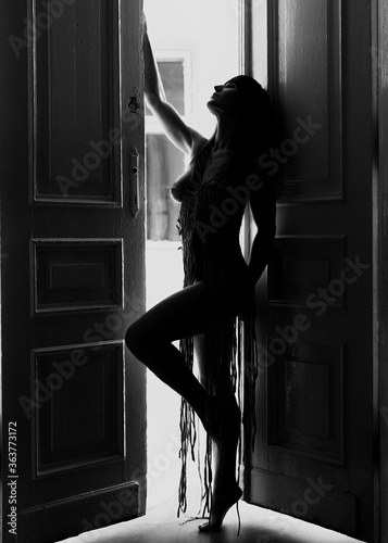 Photo Woman Standing Against Door At Home
