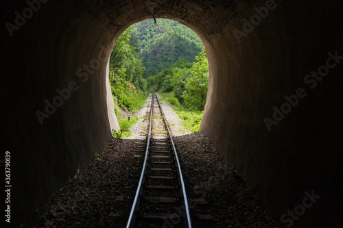 Old railway tunnel on Narrow-gauge railway, Tourist Attraction, old-fashioned tr Fotobehang