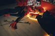 Woman lies on the floor in red vinyl coat with neon light