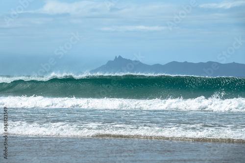 Big ocean wave breaking on the beach. Whangarei, New Zealand © sardinelly