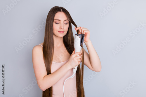 Fotografie, Obraz Photo of beautiful model lady long hairstyle hold electric styler curler making
