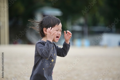Girl Crying While Running Outdoors Wallpaper Mural