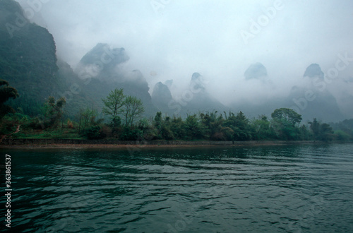 Fotografiet Scenic View Of Lake During Foggy Weather