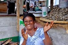 A Woman Sells Fish At The Makola Market In Accra, Ghana