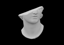 Fragment Of Broken Colossal Head Sculpture In Classical Antique Style Isolated On Black Background In Grey Scale. 3D Rendered Illustration.