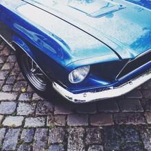 Blue Car On Cobblestone
