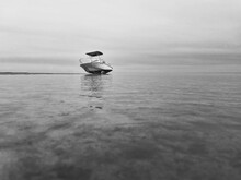 Boat In Sea Against Sky Low Tide
