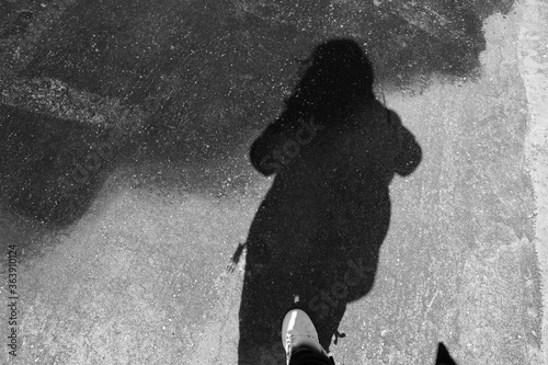 Fotografie, Obraz Low Section Of Silhouette Woman Standing On Puddle