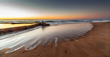 African Stock Photo Of A South African, Kwa-Zulu Natal South Coast Beach Scene With The Sun Rising Of The Ocean