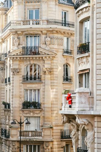 Fototapeta View Of Residential Building With Santa Decoration, Paris obraz