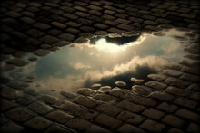 High Angle View Of Clouds Reflection In Puddle On Cobblestone Street