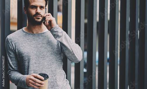 Cuadros en Lienzo Confident male entrepreneur having phone conversation in roaming with administra