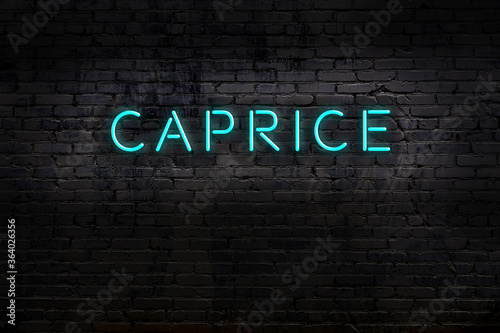 Fotografie, Tablou Night view of neon sign on brick wall with inscription caprice