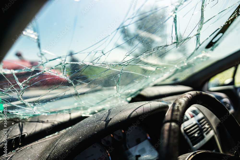 Closeup of crashed car window in car accident. - obrazy, fototapety, plakaty