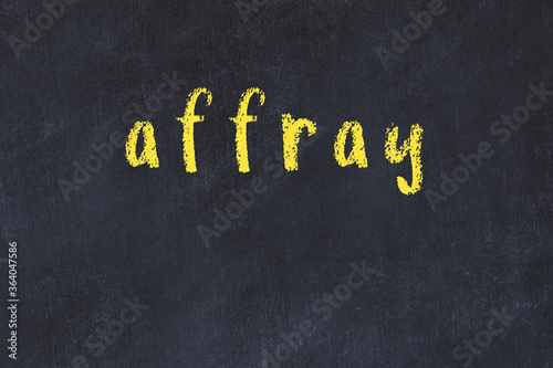 College chalk desk with the word affray written on in Canvas Print