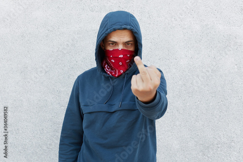 Close up photo of young guy in bandana mask calls for stopping police brutality, showing fuck symbol, fight for equal rights and against racism isolated over white background Canvas Print