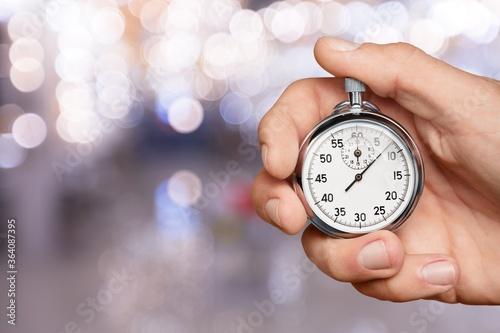 Valokuvatapetti Silver classic stopwatch in human hand