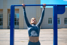 Girl Doing Exercises On Horizo...