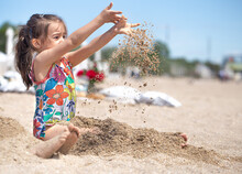 Little Girl Playing With Sand ...