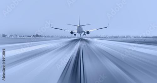 Passenger airplane landing to airport with motion blur Fototapet
