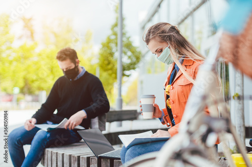 Two college students learning while keeping social distance Canvas Print