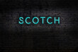 canvas print picture - Night view of neon sign on brick wall with inscription scotch