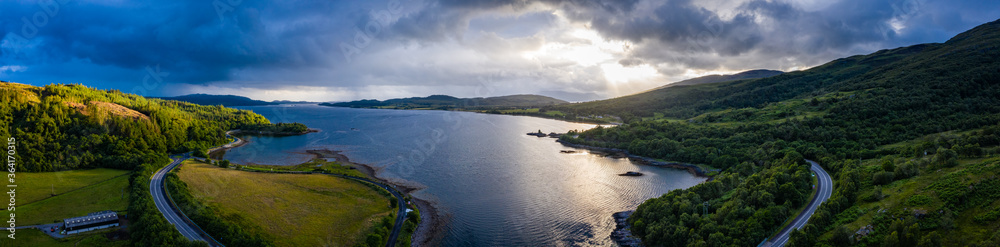Fototapeta aerial shot of loch creran on the west coast of the argyll region of the scottish highlands on a summer evening during stormy weather