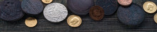 Numismatics. Old Collectible Coins Made Of Silver, Gold And Copper On A Wooden Table. Top View.