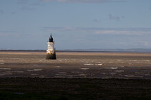 Plover Scar Lighthouse, Also Known As The Abbey Lighthouse, Is An Active 19th-century Lighthouse Sited At The Entrance Of The Lune Estuary, Near Cockersand Abbey In Lancashire, England.