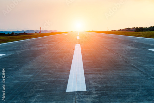 airstrip in the airport terminal with marking on blue sky Canvas