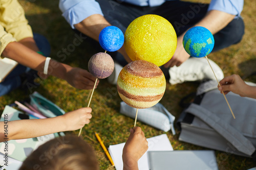 Leinwand Poster Close up of group of children holding model planets while enjoying outdoor astro