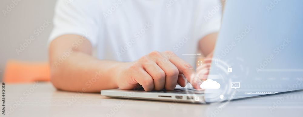 Fototapeta programmer man hand typing on keyboard for transfer or synch data upload and download from cloud computing with virtual interface in operation room, technology business concept