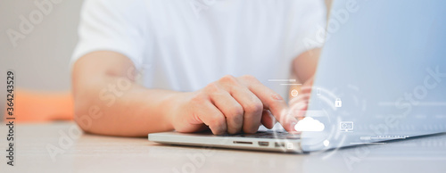 Fototapeta programmer man hand typing on keyboard for transfer or synch data upload and download from cloud computing with virtual interface in operation room, technology business concept obraz