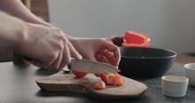Man Chop Tomatoes On Olive Woo...