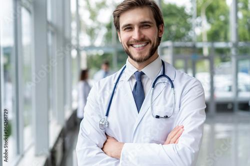 Obraz happy male medical doctor portrait in hospital. - fototapety do salonu