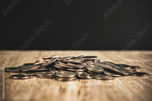 Fototapeta A pile of many coins on the table For money saving ideas And financial planning for the family obraz