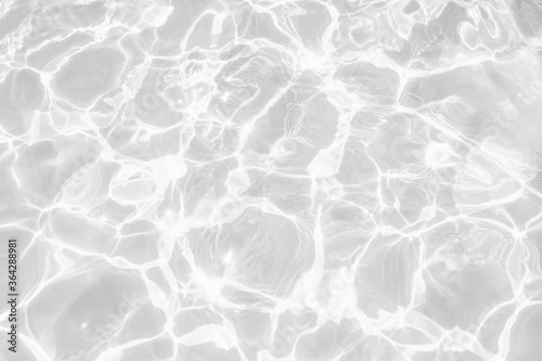 Fototapeta Closeup of desaturated transparent clear calm water surface texture with splashes and bubbles