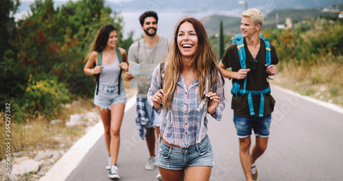 Foto Group of happy friend traveler walking and having fun