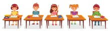 Primary School Pupils Sit At D...