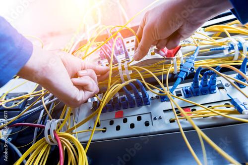 Network engineer working in server room Wallpaper Mural